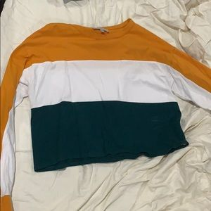 Long sleeve orange ,white and green shirt